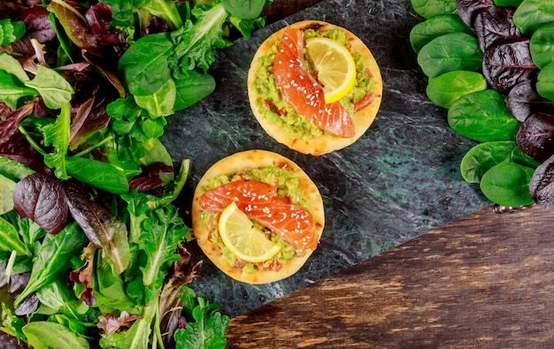 Toasts with avocado smoked salmon and green salad