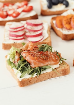 Toasts with different ingredients for party
