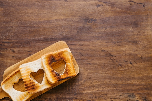 Toasts with hearts on board