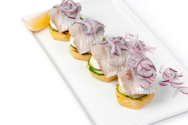 Toasts with herring appetizer isolated
