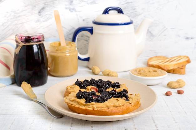 Toasts with peanut butter and berry jam