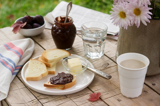 Toasts with plum chocolate jam and cocoa. breakfast in the garden. rustic style