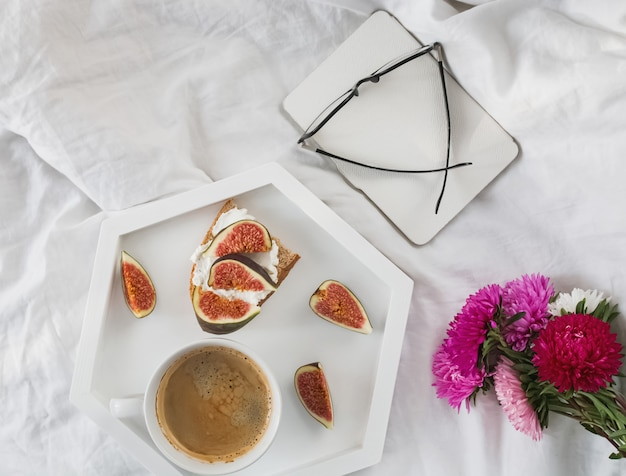 Toasts with ricotta and figs and coffee. top view