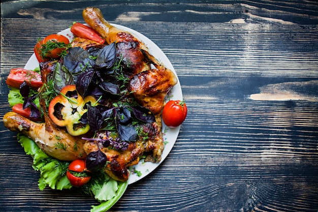 Tobacco chicken and fresh vegetables