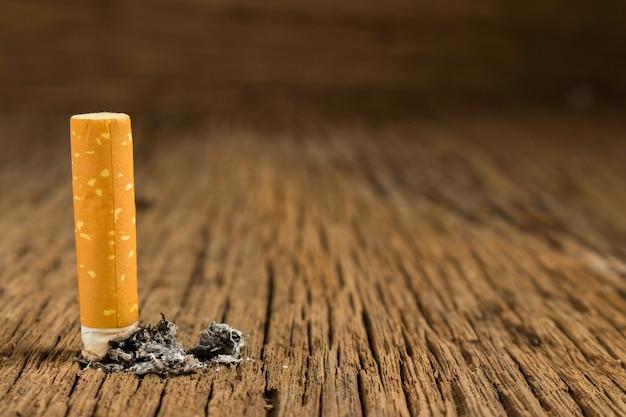 Tobacco cigarette. stub.  on wooden
