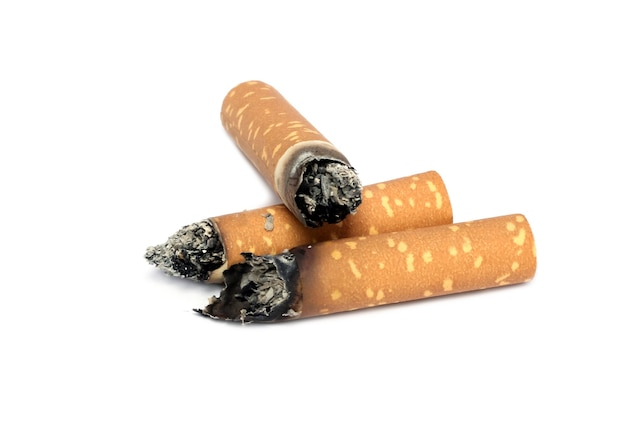 Tobacco with torn cigarette on white background