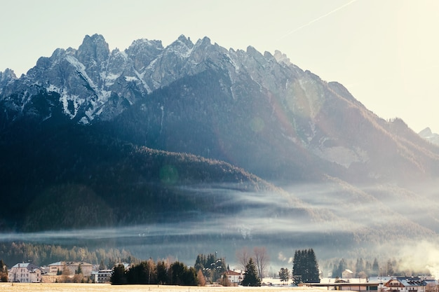 Toblach city and mountains covered in snow