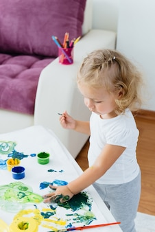 Toddler child painting at home creative free time