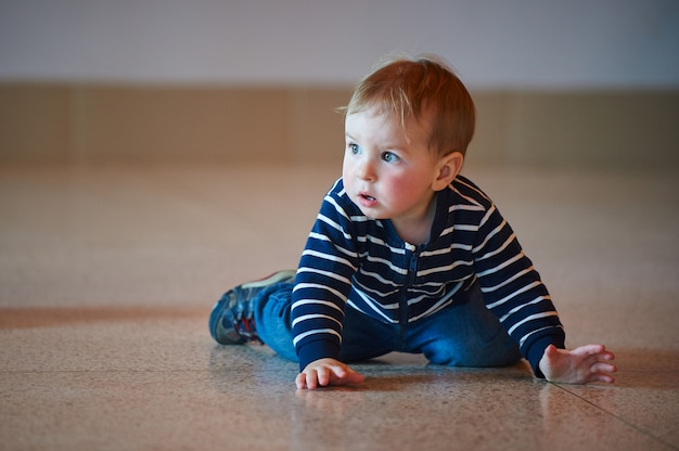 Toddler crawling on floor at shopping center
