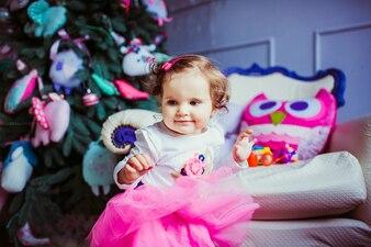 Toddler girl in pink skirt standing