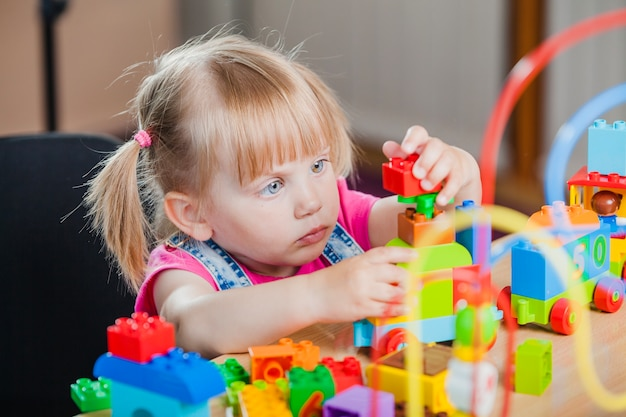 Toddler girl with colorful toys