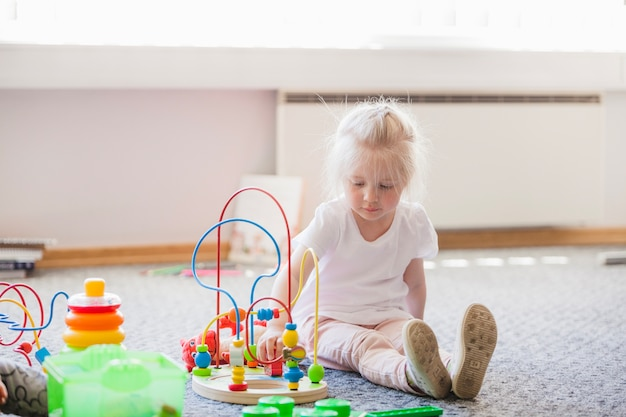Toddler in playroom with educational toy
