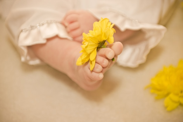 Toddler's feet. baby's feet with flowers