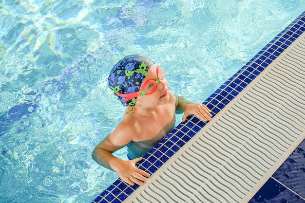 Toddler swimming training in the pool