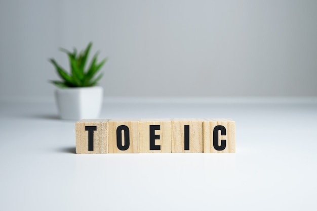 Toeic word on wooden cubes. toeic concept.