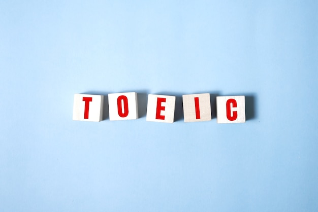 Toeic word on wooden cubes. toeic concepts.