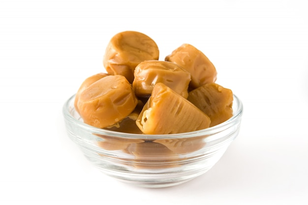 Toffee caramel candies isolated on white