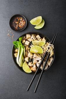 Tofu asian vegetarian soup served in bowl