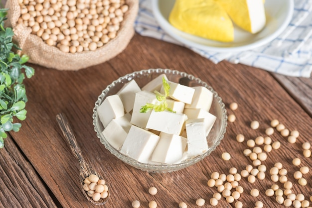 Tofu cut into cubes in bowl with soy bean.