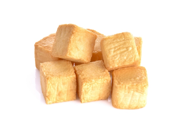 Tofu fish cubes on a white surface