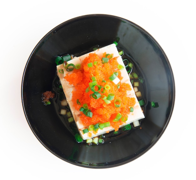 Tofu japanese style topped tobiko egg and spring onions