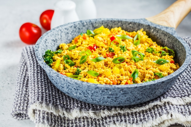Tofu scramble with vegetables in a pan