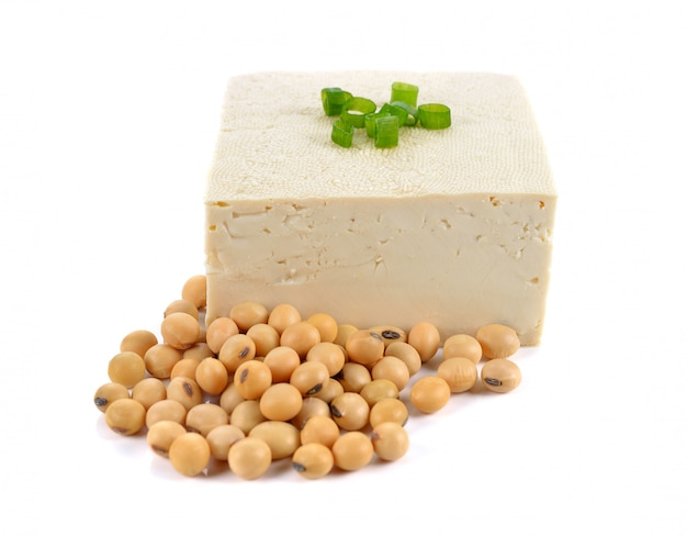Tofu and soy beans on white background