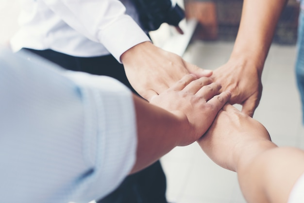 Together collaborate of hands teamwork in meeting room office