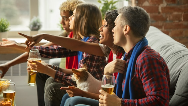 Together. excited people watching sport match, championship at home. multiethnic group of friend, fans cheering for favourite national basketball, tennis, soccer, hockey team. concept of emotions.