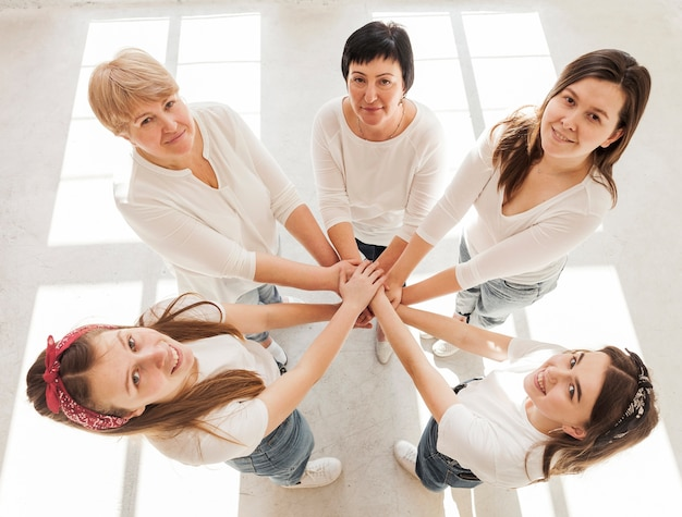 Togetherness group of women holding hands