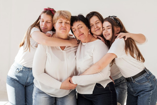 Togetherness group of women hugging