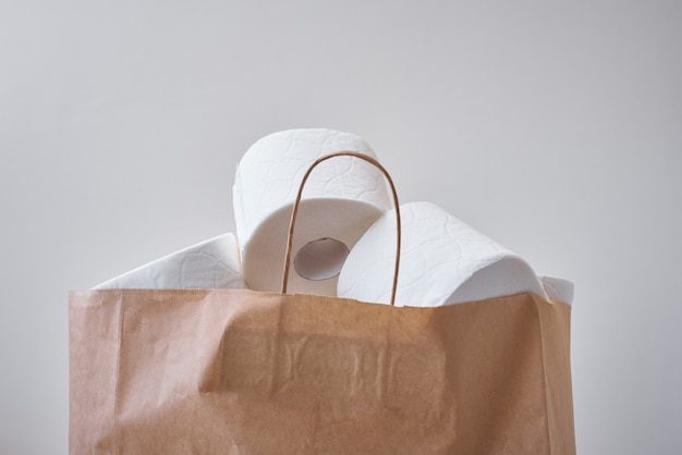 Toiket paper rolls in a shopping bag. buying panic about coronavirus covid-19 for home quarantine concept