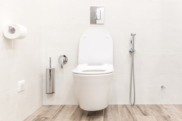 Toilet bowl in modern white hitech bathroom