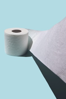 Toilet paper on blue