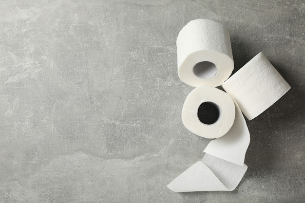 Toilet paper on grey table