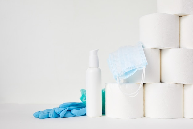 Toilet paper, hand sanitizer and medical mask. the panic of the coronavirus epidemic