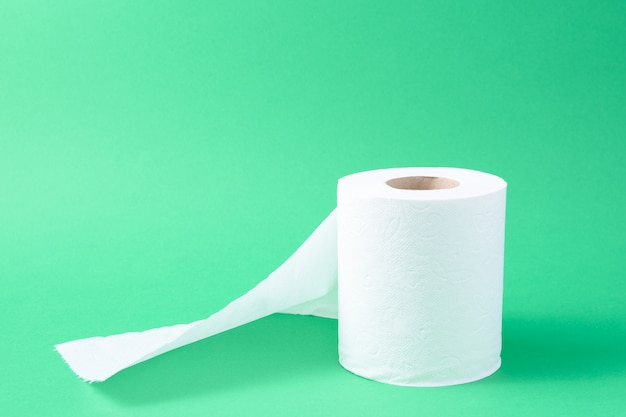Toilet paper isolated in a green background