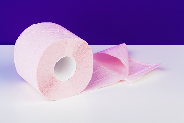 Toilet paper rolls isolated on white table