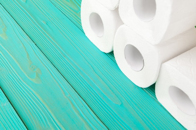 Toilet paper rolls on turquoise bright background