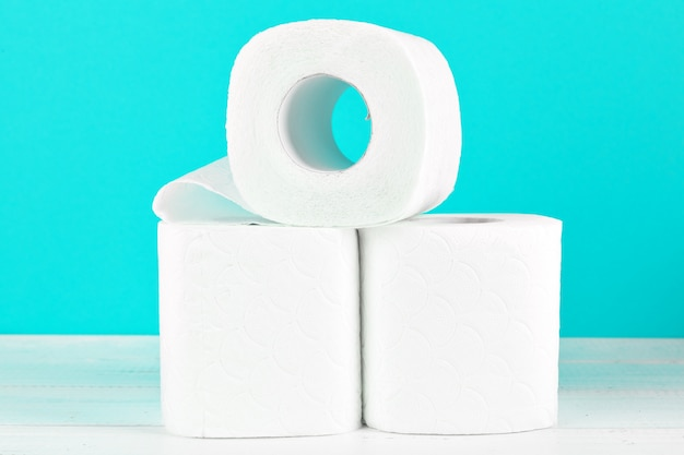 Toilet paper rolls on turquoise bright