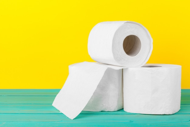Toilet paper stacks  on bright yellow