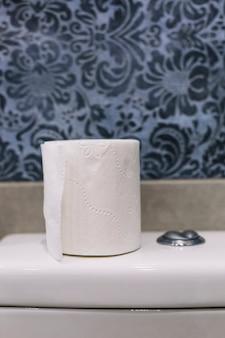 Toilet paper on tank