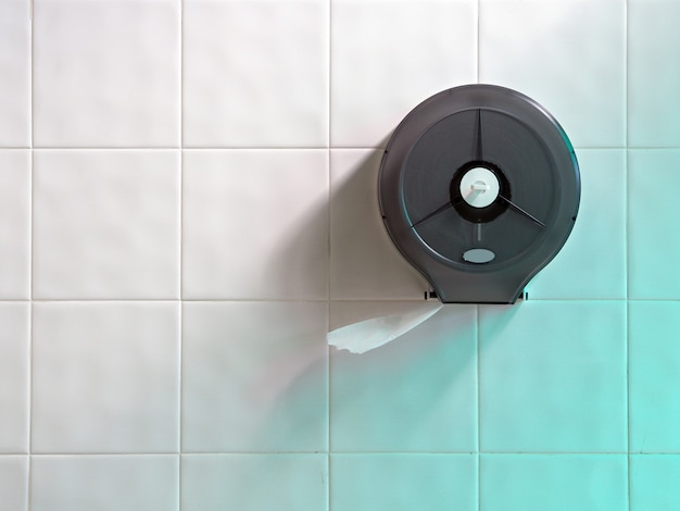 Toilet paper on white wall