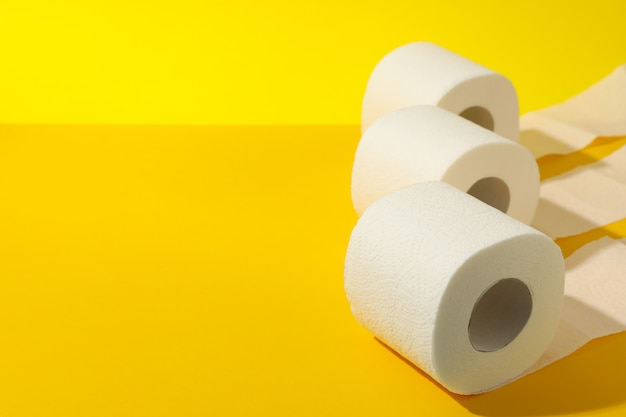 Toilet paper on yellow table