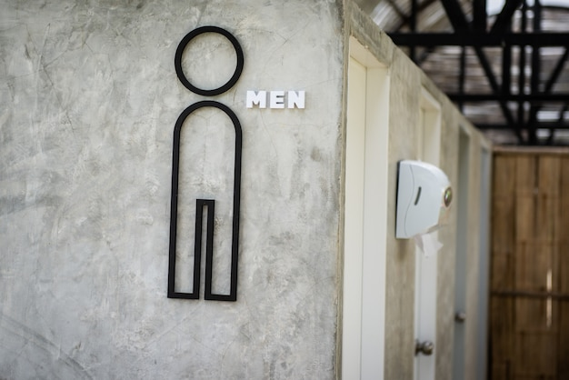 Toilet point symbol on wall grey color make with black steel