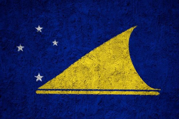 Tokelau flag painted on grunge wall