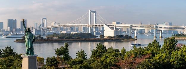 Tokyo skyline cityscape at odaiba with rainbow bridge and tokyo tower.