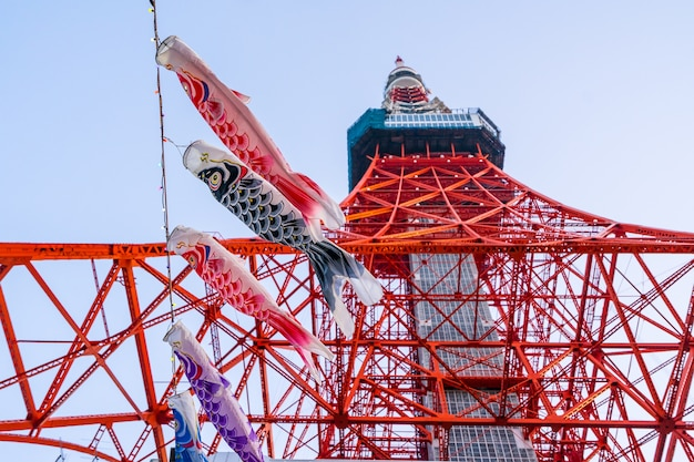 Tokyo tower with koinoborii in japan looking from bottom