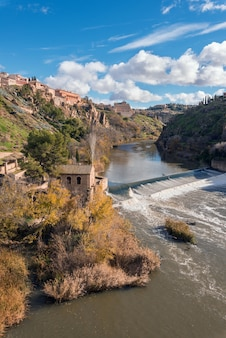 Toledo cityscape, old medieval city over tajo river, spain.