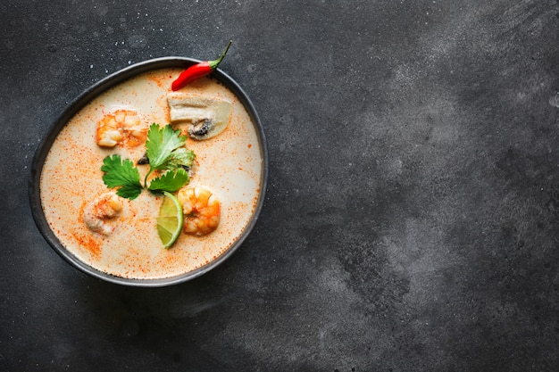 Tom yam kung spicy thai soup with shrimp, seafood, coconut milk, chili pepper.